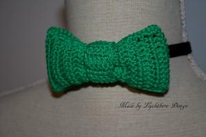 Flugan Hugo grön med logga